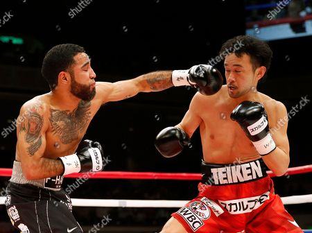 Stock Photo of Shinsuke Yamanaka, Luis Nery. Mexico's Luis Nery, left, sends a left to Japan's Shinsuke Yamanaka in the first round of their rematch for the WBC bantamweight world boxing title in Tokyo . Nery knocked out Yamanaka in the second round to clinch the title