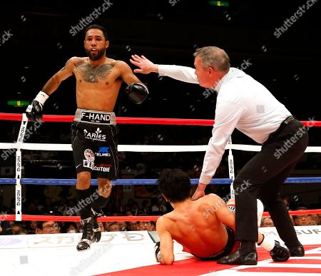 Shinsuke Yamanaka, Luis Nery. Mexico's Luis Nery, left, reacts after knocking down Japan's Shinsuke Yamanaka in the second round of their rematch for the WBC bantamweight world boxing title in Tokyo . Nery knocked out Yamanaka in the round to clinch the title