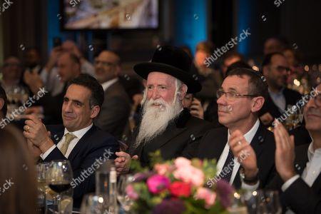 Maurice Benisty, Rabbi Yitzchak Dovid Grossman and Ambassador Mark Regev.