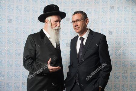 Rabbi Yitzchak Dovid Grossman with Israeli Ambassador Mark Regev.