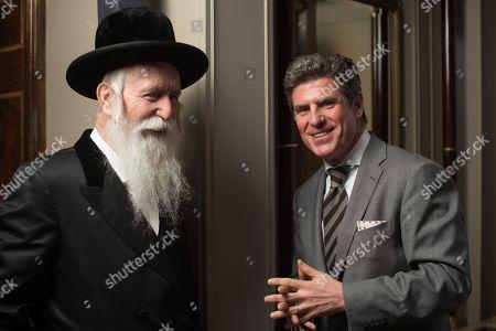 Rabbi Yitzchak Dovid Grossman with Oren Peleg, CEO of Fitness First.
