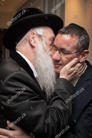 Rabbi Yitzchak Dovid Grossman, founder of Migdal Ohr, with Israeli Ambassador Mark Regev.