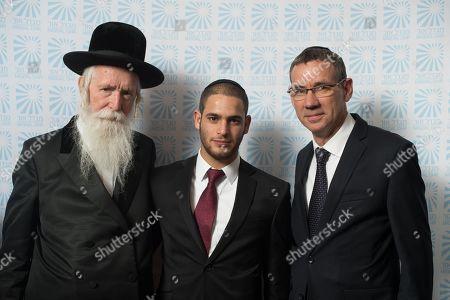 Rabbi Yitzchak Dovid Grossman, paratrooper Daniel Rosenberg and Israeli Ambassador Mark Regev.