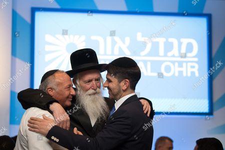 Joey Esfandi, Rabbi Yitzchak Dovid Grossman and Yossi Roash.