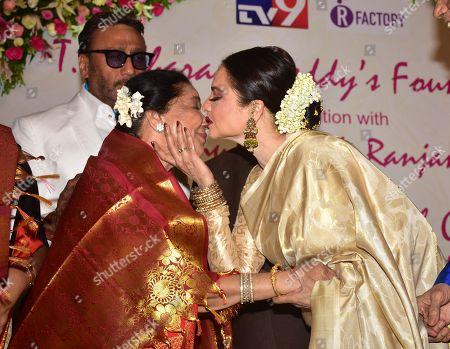 Stock Photo of Indian playback singer Asha Bhosle and Rekha