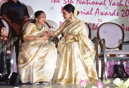 Indian playback singer Asha Bhosle and Rekha