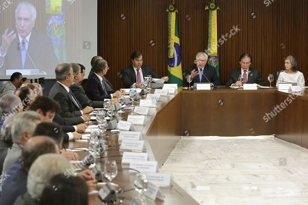 Michel Temer, Rodrigo Maia, Eunicio Oliveira, Carmen Lucia. Brazil's President Michel Temer, center front, speaks flanked by Chamber of Deputies Speaker Rodrigo Maia, left, Senate leader Eunicio Oliviera and Chief Justice Carmen Lucia, during a meeting with state governors, at the Planalto Presidential Palace, in Brasilia