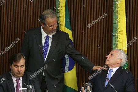 Michel Temer, Raul Jungmann, Rodrigo Maia. Brazil's President Michel Temer looks up at Brazil's newly-appointed Public Security Minister Raul Jungmann during a meeting with state governors at the Planalto Presidential Palace, in Brasilia, . Temer met with the state leaders to discuss the newly created Public Safety Ministry, and to begin work on a national plan to combat crime. Pictured left is Chamber of Deputies Speaker Rodrigo Maia