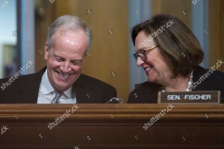 Jerry Moran; Deb Fischer. Senate Committee on Environment & Public Works members Sen. Jerry Moran, R-Kan., left, and Sen. Deb Fischer, R-Neb., share a laugh during the Committee's hearing on the administration's rebuilding infrastructure framework, on Capitol Hill in Washington