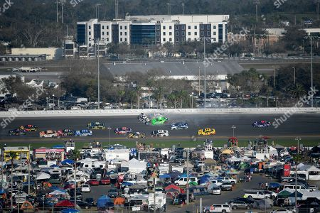 Chase Elliott, Kasey Kahne, Danica Patrick. Chase Elliott (9), Kasey Kahne (95) and Danica Patrick (7) collide between Turns 3 and 4 during the NASCAR Daytona 500 auto race at Daytona International Speedway, in Daytona Beach, Fla