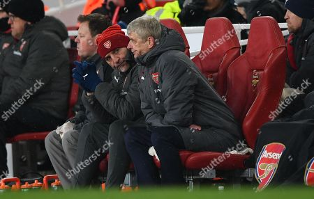 (CAPTION CORRECTION) Arsene Wenger manager of Arsenal and Steve Bould  looking hopeless during 1st half