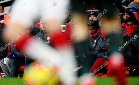 (CAPTION CORRECTION) Arsene Wenger manager of Arsenal and Steve Bould watching