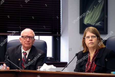 Alaska state Rep. Tammie Wilson, right, sits next to State Rep. Steve Thompson during a House minority news conference, in Juneau, Alaska. Wilson says she has taken required training to prevent harassment and discrimination after being assured that an updated legislative policy addressing sexual and other harassment would be vetted by a third-party