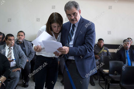 Stock Image of Juan Alberto Fuentes, former Guatemalan finance minister, stands with his lawyer just before the court ruling on whether he will be released, in Guatemala City, . A judge is to decide whether a case of suspected corruption proceeds against former President Alvaro Colom and 12 former Cabinet ministers, that include Fuentes who recently resigned as the president of Oxfam International