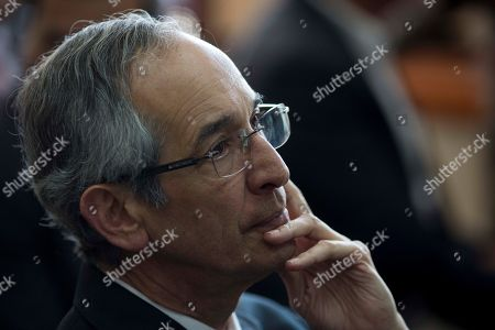 Former Guatemalan President Alvaro Colom sits in a courtroom waiting to hear on whether he will be released, in Guatemala City, . Colom defended his actions Wednesday in a case of suspected corruption involving bus concessions, saying his order for a $35 million upgrade to the public transit system was legitimate