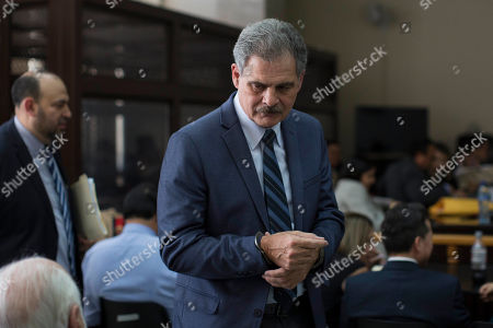 Stock Photo of Juan Alberto Fuentes, former Guatemalan finance minister, arrives handcuffed for the ruling on whether he will be released, in Guatemala City, . A judge is to decide whether a case of suspected corruption proceeds against former President Alvaro Colom and 12 former Cabinet ministers, that include Fuentes who recently resigned as the president of Oxfam International