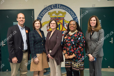 From left Chuck Scofield, executive vice president, No Kid Hungry, Erin Ward, associate manager, government relations, Kellogg Company, Stephanie Slingerland, director, philanthropy, Kellogg Company, Pierrette Peters, principal, Francis Hammond Middle School, Lauren Beck, senior director, government relations, Kellogg Company visit Francis Hammond Middle School's breakfast in the classroom program on in Alexandria, Va. No Kid Hungry partners with Kellogg's to make breakfast part of the school day for millions of kids across America