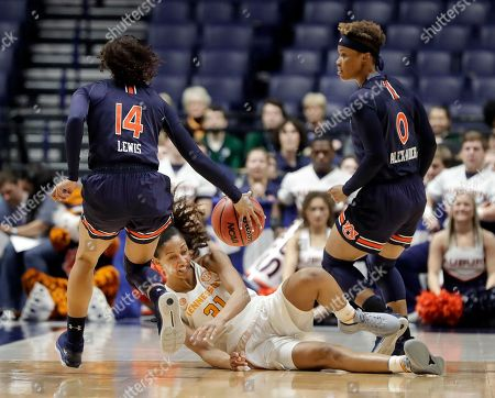 Jaime Nared, Tiffany Lewis, Daisa Alexander. Tennessee guard/forward Jaime Nared (31) falls as she chases down the ball with Auburn's Tiffany Lewis (14) and Daisa Alexander (0) in the first half of an NCAA college basketball game at the women's Southeastern Conference tournament, in Nashville, Tenn