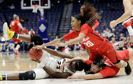 Amber Smith, Madinah Muhammad, Cecilia Muhate. Missouri guard Amber Smith (23) fights for the ball with Mississippi guard Madinah Muhammad (20) and Cecilia Muhate, bottom right, in the first half of an NCAA college basketball game at the women's Southeastern Conference tournament, in Nashville, Tenn