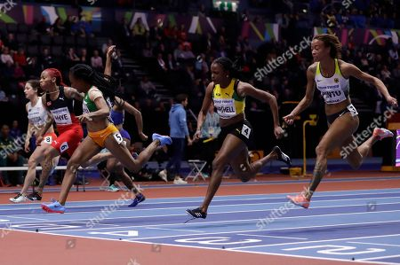 Germany's Tatjana Pinto, Jamaica's Rushelle Burton and Ivory Coast's Marie-Josee Ta Lou, from right to left, compete in a semifinal of the women's 60 meters race at the World Athletics Indoor Championships in Birmingham, Britain