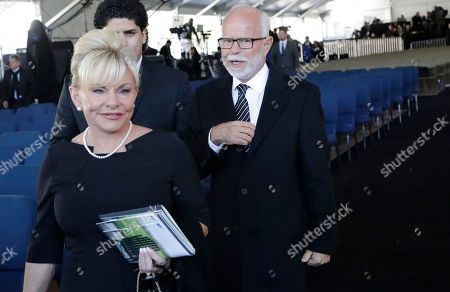 Televangelist Jim Bakker, right, walks with his wife Lori Beth Graham after a funeral service at the Billy Graham Library for the Rev. Billy Graham, who died last week at age 99, in Charlotte, N.C