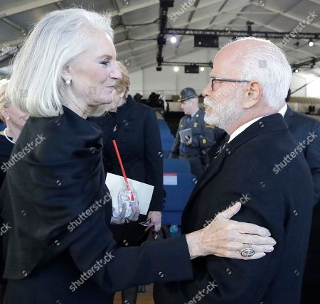 Televangelist Jim Bakker speaks with Ann Graham Lots after a funeral service at the Billy Graham Library for the Rev. Billy Graham, who died last week at age 99, in Charlotte, N.C