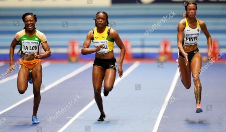 Marie Josee Ta Lou of the Ivory Coast (L) Remona Burchell of Jamica (C) and Tatjana Pinto of Germany (R) in action during the 60 metres Women's semi final  during the IAAF Athletics World Indoor Championships at Arena Birmingham, Britain, 02 March 2018.