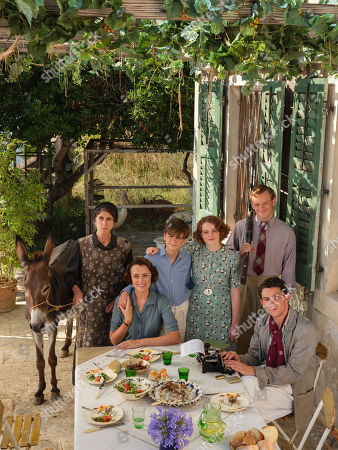 Stock Image of Milo Parker as Gerry Durrell, Anna Savva as Lugaretzia, Keeley Hawes as Louisa Durrell, Daisy Waterstone as Margo Durrell, Callum Woodlouse as Leslie Durrell and Josh O'Connor as Larry Durrell.