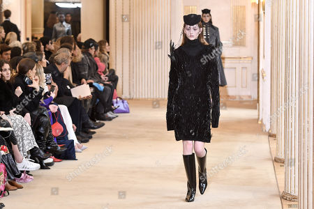 Stock Picture of A model presents a creation from the Fall/ Winter 2018/2019 Women Ready to Wear collection by French designer Guillaume Henry for Nina Ricci fashion house during the Paris Fashion Week, in Paris, France, 02 March 2018. The presentation of the Women's collections runs from 26 February to 06 March 2018.