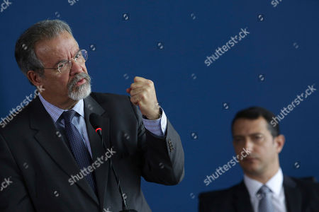 Brazil's Public Security Minister Raul Jungmann, left, speaks at the swearing-in ceremony for the new federal police chief, at the Palace of Justice in Brasilia, Brazil, . Federal Police Rogerio Galloro is pictured in background. The police force will be under the direction of the newly created Public Safety Ministry