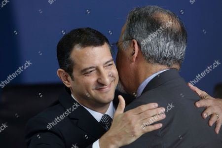 Raul Jungman, Rogerio Galloro. Newly-appointed Federal Police Chief Rogerio Galloro embraces Public Security Minister Raul Jungmann during his swearing-in ceremony at the Palace of Justice in Brasilia, Brazil, . The police force will be under the direction of the newly created Public Safety Ministry