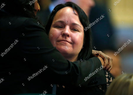 Stock Image of Colorado State Rep. Faith Winter, D-Westminster, is hugged after delivering remarks during a debate in the chamber whether to expel State Rep. Steve Lebsock, D-Thornton, over sexual misconduct allegations against Winter and other peers, in the State Capitol in Denver. The effort faces tough odds amid Republican objections to how the complaints have been handled