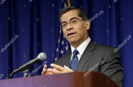 Is California Attorney General Xavier Becerra at a news conference in Sacramento, Calif. Becerra, who was appointed by Gov. Jerry Brown to fill the term of Kamala Harris after she was elected to the U.S. Senate, is being challenged by a fellow Democrat, Insurance Commissioner Dave Jones