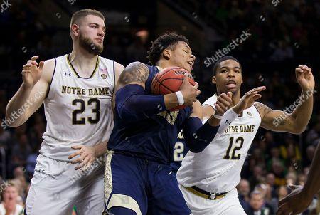 Shamiel Stevenson, Martinas Geben, Elijah Burns. Pittsburgh's Shamiel Stevenson (23) grabs the ball in front of Notre Dame's Martinas Geben (23) and Elijah Burns (12) during the second half of an NCAA college basketball game, in South Bend, Ind. Notre Dame won 73-56