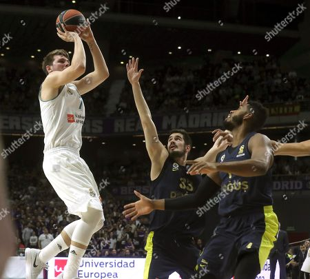 Real Madrid's Luka Doncic (L) and Fenerbahce's Nikola Kalinic (C) and Jason Thompson (R) in action during their Euroleague basketball match at the Sports Palace in Madrid, Spain, 02 March 2018.