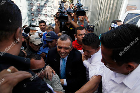 Honduran ex-President Porfirio Lobo, center, arrives to accompany his wife Rosa Elena Bonilla as they arrive at court in Tegucigalpa, Honduras, . Bonilla is facing corruption charges after investigators for the non-governmental National Anti-corruption Council told prosecutors that she deposited $600,000 in government funds into her personal bank account five days before Lobo ended his four-year term in January 2014. They also say she hasn't accounted for at least $6 million in government funds for her office during Lobo's administration