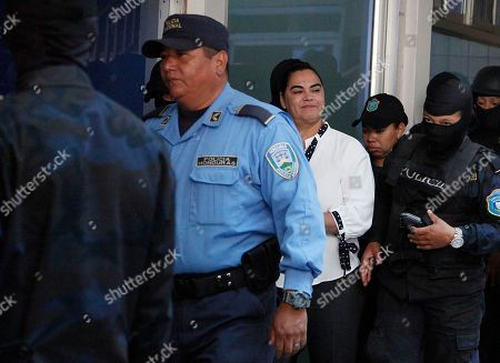 Honduran former first lady Rosa Elena Bonilla, third from left, arrives at court in Tegucigalpa, Honduras, . Bonilla is facing corruption charges after Investigators for the non-governmental National Anti-corruption Council told prosecutors that she deposited $600,000 in government funds into her personal bank account five days before her husband, President Porfirio Lobo, ended his four-year term in January 2014. They also say she hasn't accounted for at least $6 million in government funds for her office during Lobo's administration