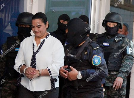 Honduran former first lady Rosa Elena Bonilla, left, arrives at court in Tegucigalpa, Honduras, . Bonilla is facing corruption charges after Investigators for the non-governmental National Anti-corruption Council told prosecutors that she deposited $600,000 in government funds into her personal bank account five days before her husband, President Porfirio Lobo, ended his four-year term in January 2014. They also say she hasn't accounted for at least $6 million in government funds for her office during Lobo's administration