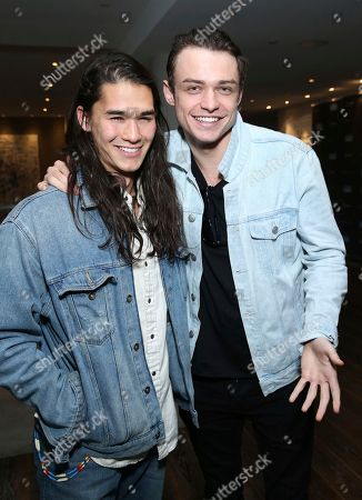 Thomas Doherty, Booboo Stewart. Booboo Stewart, left, and Thomas Doherty attend Day 2 of the Kari Feinstein Style Lounge at the Andaz Hotel on in West Hollywood, Calif