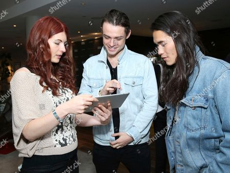 Thomas Doherty, Booboo Stewart. Booboo Stewart, from right, and Thomas Doherty attend Day 2 of the Kari Feinstein Style Lounge at the Andaz Hotel on in West Hollywood, Calif