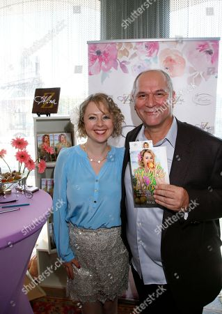 Alina Z, John Kapelos. John Kapelos, right, poses with Chef Alina Z at Day 1 of the Kari Feinstein Style Lounge at the Andaz Hotel on in West Hollywood, Calif