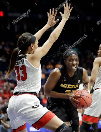 Amber Smith, Mackenzie Engram. Missouri guard Amber Smith, right, drives against Georgia's Mackenzie Engram (33) in the first half of an NCAA college basketball game at the women's Southeastern Conference tournament, in Nashville, Tenn