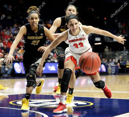 Cierra Porter, Mackenzie Engram. Georgia's Mackenzie Engram (33) and Missouri's Cierra Porter (21) chase after a loose ball in the second half of an NCAA college basketball game at the women's Southeastern Conference tournament, in Nashville, Tenn