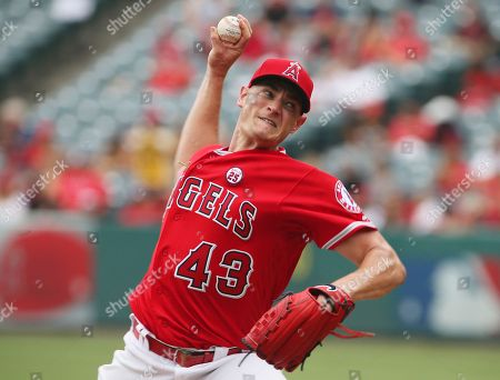 Los Angeles Angels pitcher Garrett Richards works against the Texas Rangers in the first inning of a baseball game in Anaheim, Calif. Richards is not interested in dwelling on all the time he missed, all the countless hours of rehab, rather turning his attention to what he can do to help the Angels now that he's healthy at last. Last year, Richards had prepared to pitch for a full season after working his way back from a torn ulnar collateral ligament in his elbow for which he underwent stem cell therapy instead of having the more common Tommy John reconstructive surgery. Then he was hurt again in his season debut