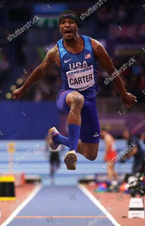 United States' Chris Carter makes an attempt in the men's triple jump final at the World Athletics Indoor Championships in Birmingham, Britain