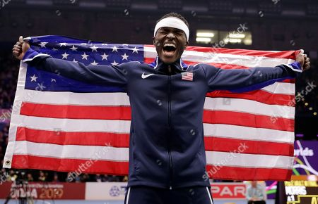 United States' Will Claye celebrates after winning the gold medal in the men's triple jump final at the World Athletics Indoor Championships in Birmingham, Britain
