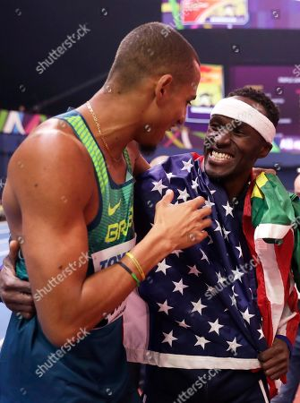 Gold medalist United States' Will Claye, right, celebrates with silver medalist Brazil's Almir Dos Santos after the men's triple jump final at the World Athletics Indoor Championships in Birmingham, Britain