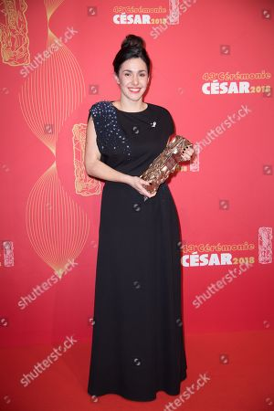 "Stock Photo of French director Alice Vial poses with the trophy for winning the Best Short Film award for the film ""Les Bigorneaux""."