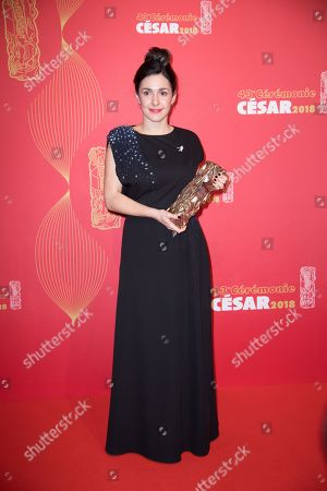 """Stock Photo of French director Alice Vial poses with the trophy for winning the Best Short Film award for the film """"Les Bigorneaux""""."""