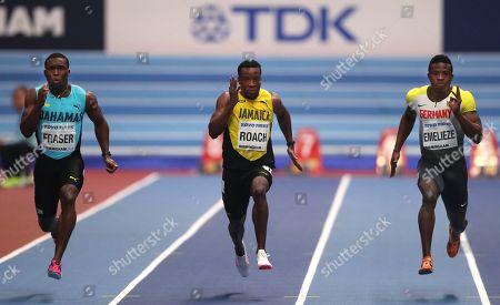 Stock Image of Bahamas' Warren Fraser, Jamaica's Kimmari Roach, Germany's Peter Emelieze, from left, compete in a men's 60-meter heat at the World Athletics Indoor Championships in Birmingham, Britain